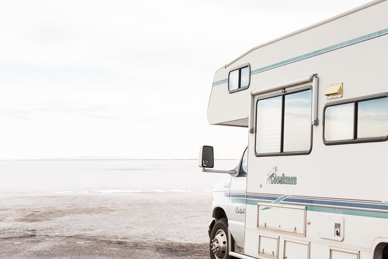A Coachmen motorhome traveling on the Bonneville Salt Flats