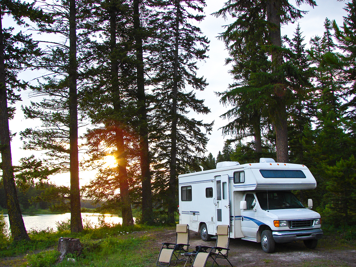 Recreational Vehicle Set-up at a Campsite Near the Lake.
