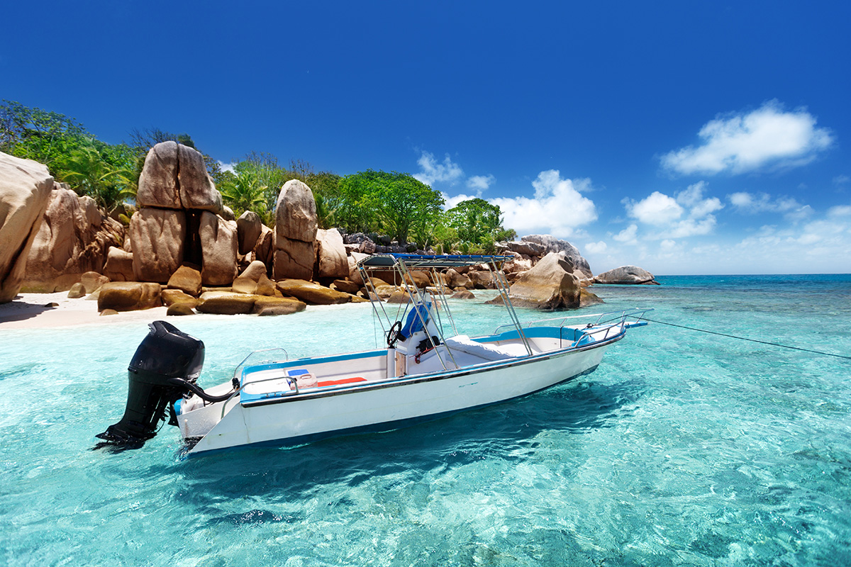 Speed Boat parked by Coco Island beach in Seychelles.